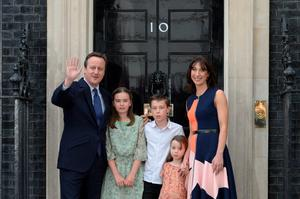 Outgoing British prime minister David Cameron (L) waves outside 10 Downing Street with his family (L-R) his daughter Nancy Gwen, son Arthur Elwen, daughter Florence Rose Endellion and his wife Samantha Cameron in central London on July 13, 2016 before going to Buckingham Palace to tender his resignation to Queen Elizabeth II.  Outgoing British prime minister David Cameron urged his successor Theresa May on Wednesday to maintain close ties with the EU even while negotiating to leave it, as he paid a fond farewell to MPs hours before leaving office. Cameron will tender his resignation on July 13 to Queen Elizabeth II at Buckingham Palace, after which the monarch will task the new leader of the Conservative Party Theresa May with forming a government.  / AFP PHOTO / OLI SCARFFOLI SCARFF/AFP/Getty Images
