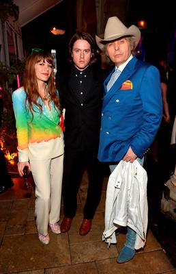LOS ANGELES, CA - FEBRUARY 08:  (L-R) Singers Jenny Lewis, Johnathan Rice and Dwight Yoakam attend the Warner Music Group annual Grammy celebration at Chateau Marmont on February 8, 2015 in Los Angeles, California.  (Photo by Charley Gallay/Getty Images for  Warner Music Group)