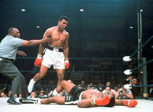 In this May 25, 1965, file photo, heavyweight champion Muhammad Ali is held back by referee Joe Walcott, left, after Ali knocked out challenger Sonny Liston in the first round of their title fight in Lewiston, Maine.  Ali, the magnificent heavyweight champion whose fast fists and irrepressible personality transcended sports and captivated the world, has died according to a statement released by his family Friday, June 3, 2016. He was 74. (AP Photo/File)