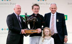 Tony McCoy receives a lifetime achievement award from Liam Brady (left) on behalf of Sandown Racecourse during the bet365 Jump Finale at Sandown Racecourse, Surrey. PRESS ASSOCIATION Photo. Picture date: Saturday April 25, 2015. See PA story RACING Sandown. Photo credit should read: David Davies/PA Wire