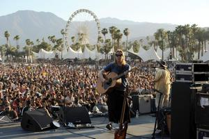 INDIO, CA - APRIL 13:  Musician Brian Ritchie and Gordon Gano of the band Violent Femmes perform onstage during day 2 of the 2013 Coachella Valley Music & Arts Festival at the Empire Polo Club on April 13, 2013 in Indio, California.  (Photo by Kevin Winter/Getty Images for Coachella)