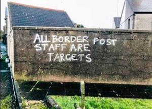 """Sinister graffiti warning that """"all border post staff are targets"""" has appeared near Larne Port."""