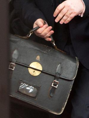 Tim Barrow, the UK Permanent Representative to the EU, carries a briefcase as he arrives at the Europa building in Brussels on Wednesday, March 29, 2017. British Prime Minister Theresa May has signed a letter invoking Article 50 of the bloc's key treaty, the formal start of exit negotiations. (AP Photo/Virginia Mayo)