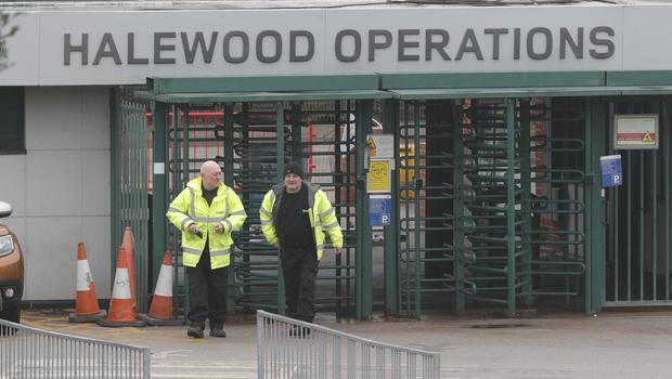 Staff outside the Halewood plant in Merseyside (Peter Byrne/PA)