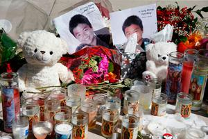 A memorial for Peter Wang, one of the victims of the Marjory Stoneman Douglas High School shooting, sits on a bandshell stage in a park in Parkland, Florida on February 16, 2018.  A former student, Nikolas Cruz, opened fire at the Florida high school leaving 17 people dead and 15 injured. / AFP PHOTO / RHONA WISERHONA WISE/AFP/Getty Images