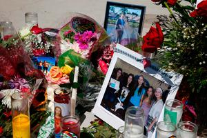 Candles, flowers and stuffed animals serve as a  memorial for the victims of the Marjory Stoneman Douglas High School shooting in a park in Parkland, Florida on February 16, 2018.  A former student, Nikolas Cruz, opened fire at the Florida high school leaving 17 people dead and 15 injured. / AFP PHOTO / RHONA WISERHONA WISE/AFP/Getty Images