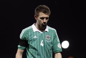 Northern Ireland's Gareth McAuley is dejected after defeat by Israel in Tuesday's World Cup Qualifier at Windsor Park, Belfast