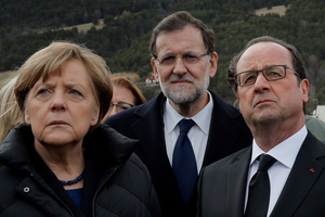 German Chancellor Angela Merkel, left, French President Francois Hollande, right, and Spanish Prime Minister Mariano Rajoy pay respect to victims in front of the mountain where a Germanwings jetliner crashed Tuesday, in Le Vernet, France, Wednesday, March 25, 2015. (AP Photo/Christophe Ena, Pool)