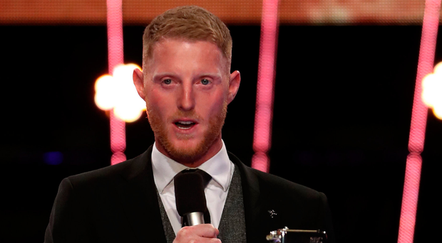 Proud moment: Ben Stokes collects his award last night