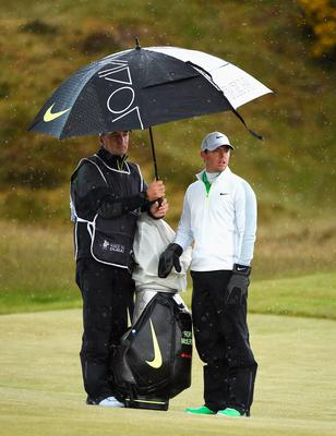 NEWCASTLE, NORTHERN IRELAND - MAY 29:  Rory McIlroy of Northern Ireland looks on with caddie JP Fitzgerald during the Second Round of the Dubai Duty Free Irish Open Hosted by the Rory Foundation at Royal County Down Golf Club on May 29, 2015 in Newcastle, Northern Ireland.  (Photo by Ross Kinnaird/Getty Images)