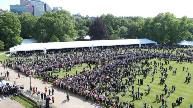Nice day for it - crowds gather in the grounds of Buckingham Palace (Ian Vogler/Daily Mirror)