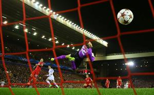 Sheer class: Cristiano Ronaldo beats Liverpool keeper Simon Mignolet for his first-ever goal at Anfield