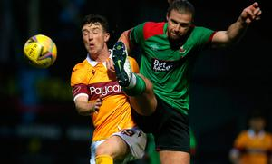 Glentoran caused Motherwell plenty of problems before a red card allowed five different scorers, including Chris Long (left) to complete a convincing rout.