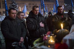 KIEV, UKRAINE - JANUARY 24: Protestors pay their respects at a tribute to a man killed during clashes with police near Independence Square on January 24, 2014 in Kiev, Ukraine. Talks to resolve the political stalemate in Ukraine have failed as anti-government protests continue in the capital and opposition leader Vitali Klitschko urges the government to call a snap election. (Photo by Rob Stothard/Getty Images)