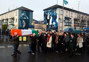 The coffin of Northern Ireland's former deputy first minister and ex-IRA commander Martin McGuinness is carried to his home in Londonderry after he died aged 66.  Niall Carson/PA Wire