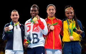(L-R) France's Sarah Ourahmoune, Great Britain's Nicola Adams, China's Ren Cancan and Colombia's Ingrit Lorena Valencia Victoria pose on the podium with their medals during the Rio 2016 Olympic Games at the Riocentro - Pavilion 6 in Rio de Janeiro on August 20, 2016.   / AFP PHOTO / Yuri CORTEZYURI CORTEZ/AFP/Getty Images