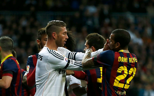Sergio Ramos of Real Madrid confronts Daniel Alves of Barcelona during the La Liga match between Real Madrid CF and FC Barcelona at the Bernabeu on March 23, 2014 in Madrid, Spain.  (Photo by Gonzalo Arroyo Moreno/Getty Images)