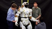 Photo issued by the University of Edinburgh of PhD students and researchers working on NASA's Valkyrie robot in the University of Edinburgh's School of Informatics. PA