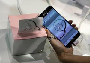 The Nemonic sticky note printer is on display at the Mangoslab booth during CES Unveiled before CES International, Tuesday, Jan. 3, 2017, in Las Vegas. The small printer prints sticky notes from a smartphone. (AP Photo/John Locher)
