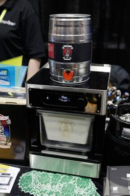 The PicoBrew automatic home beer brewer is displayed during CES Unveiled before CES International, Tuesday, Jan. 3, 2017, in Las Vegas. (AP Photo/John Locher)