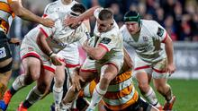 Ulster's Adam McBurney and Marty Moore with Tian Schoeman of Toyota Cheetahs (INPHO/Morgan Treacy)