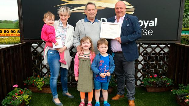 Marquee prize: Colin Weir (right) from North Down Marquees, makes a presentation to the winning owner of Zagnzig, Ballyclare man Harry Smyth. Also pictured is Emma Mooney with her children Beth, James and Marie