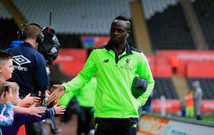 Liverpool's Sadio Mane arrives for the Premier League match at the Liberty Stadium, Swansea. PA