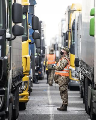 Army soldiers deliver Covid-19 tests to lorry drivers at Manston airfield in Kent (MoD/PA)
