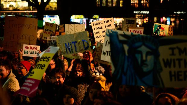 EDINBURGH, SCOTLAND - JANUARY 30: Placards are held aloft as crowds listen to a speaker at the Mound as demonstrators march to the Scottish Parliament to protest against President Trump's Muslim travel ban to the USA on January 30, 2017 in Edinburgh, Scotland. President Trump signed an executive order on Friday banning immigration to the USA from seven muslim countries. This led to protests across America and, today, in the UK a British petition asking for the downgrading of Trump's State visit passed one million signatures this morning. (Photo by Mark Runnacles/Getty Images)
