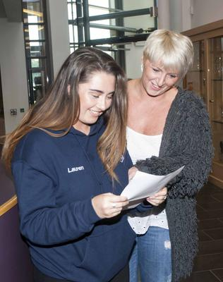 A delighted St. Mary's College, Derry student Lauren Young shows her mum Annette her A Level results at the school yesterday morning.