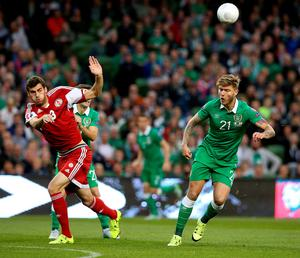 Republic of Ireland's Jeff Hendrick (right) and Georgia's Solomon Kverkvelia during the UEFA European Championship Qualifying match at the Aviva Stadium, Dublin. PRESS ASSOCIATION Photo. Picture date: Monday September 7, 2015. See PA story SOCCER Republic. Photo credit should read: Brian Lawless/PA Wire