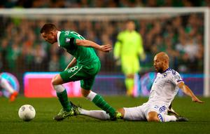 James McCarthy of the Republic of Ireland goes past the tackle from Edin Cocalic of Bosnia and Herzegovina during the UEFA EURO 2016 Qualifier play off, second leg match between Republic of Ireland and Bosnia and Herzegovina at the Aviva Stadium on November 16, 2015 in Dublin, Ireland.  (Photo by Ian Walton/Getty Images)