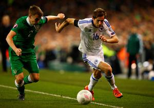 Senad Lulic of Bosnia and Herzegovina takes on Seamus Coleman of the Republic of Ireland iduring the UEFA EURO 2016 Qualifier play off, second leg match between Republic of Ireland and Bosnia and Herzegovina at the Aviva Stadium on November 16, 2015 in Dublin, Ireland.  (Photo by Ian Walton/Getty Images)