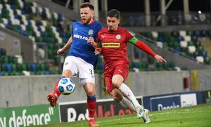 Linfield's Niall Quinn  and Cliftonville's Seanan Foster battle for the ball in their Danske Bank Premiership meeting at Windsor Park (Colm Lenaghan/Pacemaker)