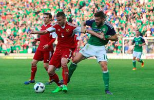 Belarus' Igor Shitov (left) and Northern Ireland's Stuart Dallas battle for the ball during the International Friendly at Windsor Park, Belfast. PRESS ASSOCIATION Photo. Picture date: Friday May 27, 2016. See PA story SOCCER N Ireland. Photo credit should read: Niall Carson/PA Wire. RESTRICTIONS: Editorial use only, No commercial use without prior permission, please contact PA Images for further information: Tel: +44 (0) 115 8447447.
