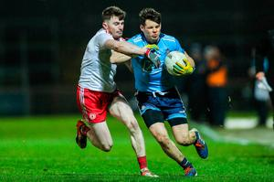 Hands off: Tyrone's Rory Brennan wrestles with Dublin's Kevin McManamon