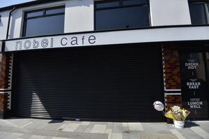 Flowers left at Cafe Nobel in Ballymena where a worker has sadly died after contracting Covid 19. Photo by Stephen Hamilton