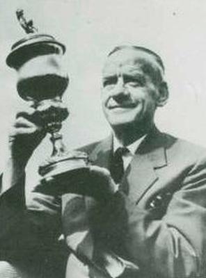 Davy Lyner holds the Vienna Cup many years after playing his part in Glentoran's triumph