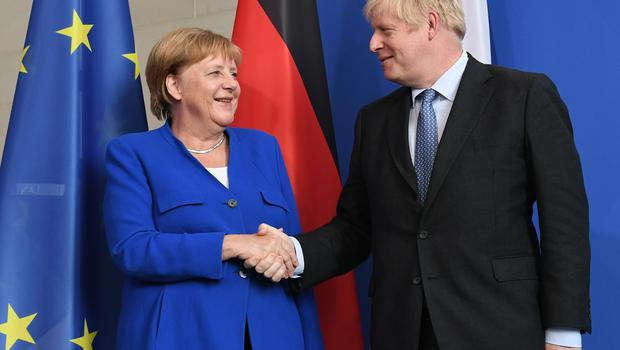 German Chancellor Angela Merkel with Prime Minister Boris Johnson in Berlin (Stefan Rousseau/PA)