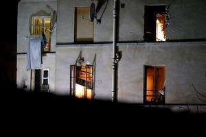 Bullet holes and smashed windows are pictured on the back side of the house after an intervention of security forces against a group of extremists in Saint-Denis, near Paris, Wednesday, Nov. 18, 2015. A woman wearing an explosive suicide vest blew herself up Wednesday as heavily armed police tried to storm a suburban Paris apartment where the suspected mastermind of last week's attacks was believed to be holed up, police said. (AP Photo/Michel Euler)