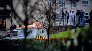 Operation: Youths congregate at the scene of a security alert on the Glengalliagh Road in Londonderry