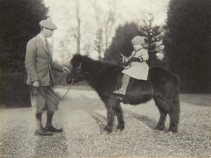 Previously unpublished family photograph issued by the Royal Collection of Queen Elizabeth II with nthe Duke of York on Shetland pony, Peggy in 1930. The pictures are to be seen by the public for the first time to coincide with a book being released this week to mark the birth of Prince George contains new pictures which show the future Queen between the ages of two and four