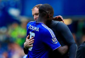 """Chelsea's Kurt Zouma embraces former teammate Petr Cech of Arsenal after the Barclays Premier League match at Stamford Bridge, London. PRESS ASSOCIATION Photo. Picture date: Saturday September 19, 2015. See PA story SOCCER Chelsea. Photo credit should read: John Walton/PA Wire. RESTRICTIONS: EDITORIAL USE ONLY No use with unauthorised audio, video, data, fixture lists, club/league logos or """"live"""" services. Online in-match use limited to 45 images, no video emulation. No use in betting, games or single club/league/player publications."""