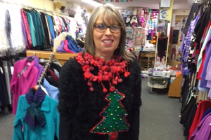 Mullans Fashion in Portstewart were collecting for Save the Children.  Gerardette Mullan'sChristmas tree design has been hand knitted & decorated with coloured jingle bells.