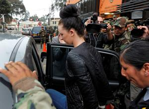 Michaella McCollum Connolly is escorted in handcuffs into a car by police as she leaves the National Police anti-drug headquarters before being driven to a court where she will be formally charged for drug trafficking in Lima, Peru, Tuesday, Aug. 20, 2013