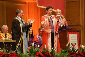 President Qun Zhao, President of the China Medical University (CMU), receives an honorary degree for his services to education from the Vice-Chancellor of Queen's University Belfast, Professor Patrick Johnston
