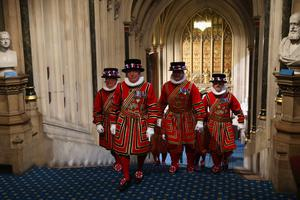 LONDON, ENGLAND - MAY 08:  Yeomen of the Guard arrive through the Norman Porch ahead of the State Opening of Parliament on May 8, 2013 in London, England. Queen Elizabeth II will unveil the coalition government's legislative programme in a speech delivered to Members of Parliament and Peers in The House of Lords today. Proposed legislation is expected to be introduced on toughening immigration regulations, capping social care costs in England and setting a single state pension rate of 144 GBP per week.  (Photo by Dan Kitwood-WPA Pool/Getty Images)