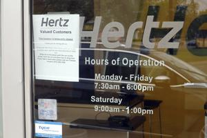 A 'Closed' notice on a Hertz car rental office during the coronavirus pandemic (Ted Shaffrey/AP)