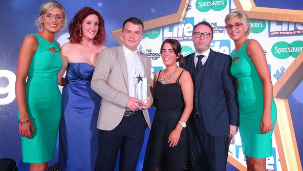 UNSUNG HERO  Winner of the Unsung Hero award, Sean McLaughlin from Derry is presented with his award by local actress Bronagh Waugh and Ruairi OÕKane from category sponsor, The National Lottery. . Also pictured are ambassadors from title sponsor Specsavers, Nicola and Alison Crimmins. Sean was one of ten winners at the Sunday Life Spirit of Northern Ireland Awards with Specsavers.