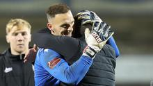 Trevor Carson is congratulated after saving all three of Coleraine's penalties to spare Motherwell's Europa League blushes.